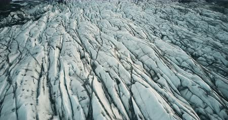 glacier point : Top aerial view of ice valley in Iceland national park. Drone flying over white glacier Vatnajokull with volcanic ash Stock Footage