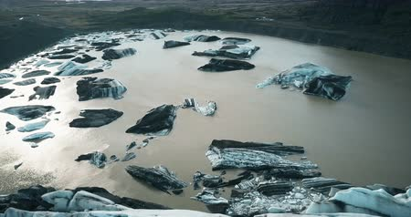glacier point : Aerial view of the glacier Vatnajokull in Iceland. Copter flying over the melting iceberg in mountains valley.