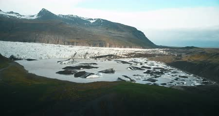 glacier point : Beautiful landscape of the lake with ice in Iceland. Copter shoot the aerial view of glacier Vatnajokull melting. Stock Footage