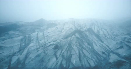 glacier point : Aerial view of the white glacier Myrdalsjokull with black ash in Iceland. Copter flying over the iceberg in the fog.