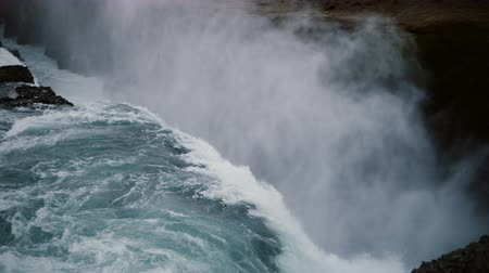 gullfoss : Beautiful view of the Gullfoss waterfall in Iceland. Turbulent flow of water falls down with splashes and foam. Stock Footage