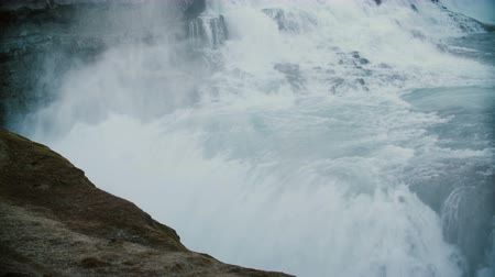 gullfoss : Scenic view of the water with splashes and foam. Beautiful landscape of the Gullfoss waterfall in Iceland. Stock Footage