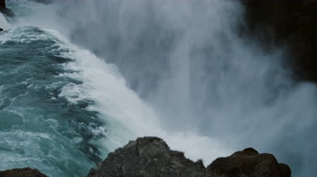 gullfoss : Close-up view of the beautiful blue water falls down from mountain. Scenic landscape of Gullfoss waterfall in Iceland. Stock Footage