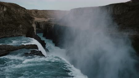 gullfoss : Beautiful landscape of the Gullfoss waterfall in iceland. Flow of water with foam and splashes falls down from the cliff