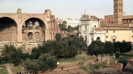 triumphal arch : Panorama of the Rome, Italy city view with its ruins, columns, palaces and an impressive Arch of Titus and Colosseum.