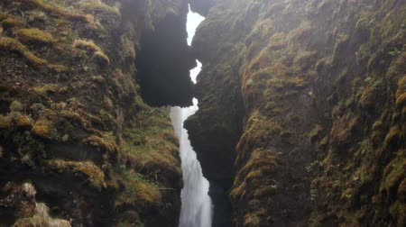 north stream : Beautiful view of powerful waterfall Gljufrabui in Iceland. Water falling down from the cliff and splashing, rainy day. Stock Footage