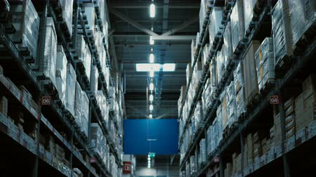 industry : Camera moving through the big warehouse or shopping mall. High shelves with many of goods for repair around. Stock Footage