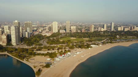 cars traffic : Aerial view of the beach on the shore of the lake Michigan. Drone flying over the Chicago, America on the dawn.