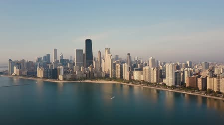 dron : Aerial view of the Chicago, USA on the shore of the lake Michigan in the down. Boat riding near the downtown. Wideo