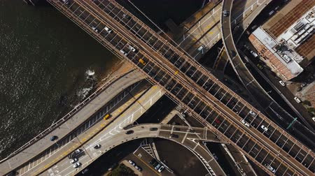 csomópont : Aerial top view of traffic road in New York, America. Drone flying over traffic intersection on shore of East river. Stock mozgókép