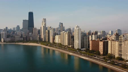 drone : Beautiful aerial view of the Chicago, America in the morning. Drone flying away from the downtown, Michigan lake.