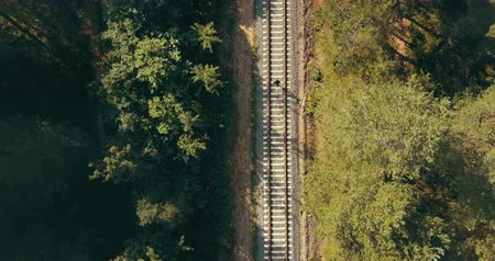 neverending : Drone top view of man running on train track. Concept of life never ending journey. Chasing dreams and surviving.