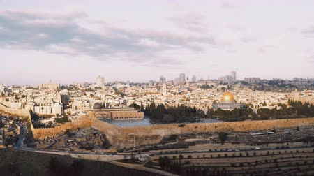 sepulcher : Panorama of old town Jerusalem, Israel. Panning right from Mount of Olives to Al-Aqsa, Temple Mount, Dome of the Rock 4K