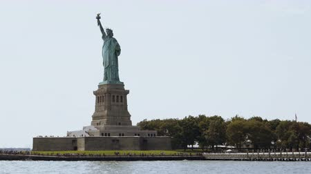 york : Famous Statue of Liberty national monument on Liberty Island in New York USA on a summer day, view from a tourist boat. Stock Footage