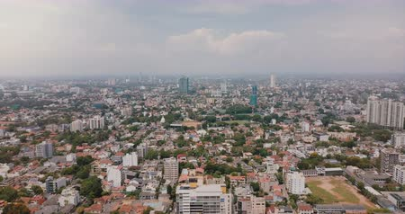 slum : Drone flying backwards high above city of Colombo, Sri Lanka. Aerial panoramic view of amazing Asian cityscape skyline.