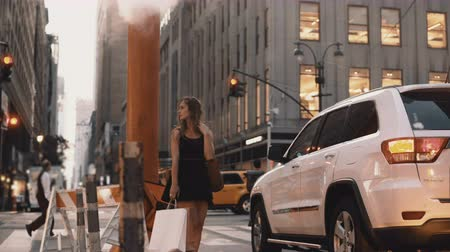 midtown manhattan : Young beautiful woman standing near the traffic road in downtown of New York, America close to smoke pipe.