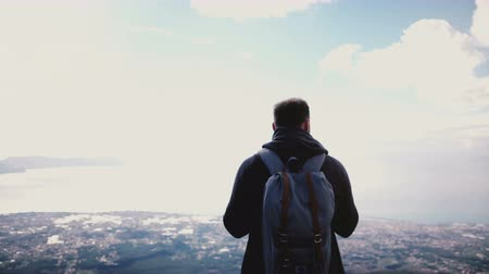 Back view successful happy tourist man enjoying amazing sky scenery view from the top of Vesuvius volcano, walking away. Stock Footage