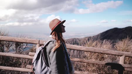 Beautiful slow motion shot of young European female travel blogger walking along Vesuvius volcano pathway slow motion.
