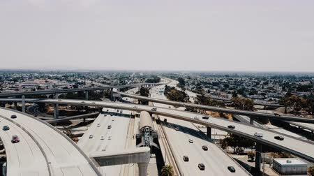 los angeles skyline : Drone flying right above incredible highway Judge Pregerson junction intersection with multiple road levels and flyovers