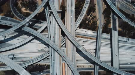 Drone zooming in on amazing Judge Pregerson junction interchange with cars moving through multiple level road flyovers.
