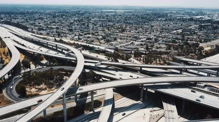 Drone flying left high above big Judge Pregerson freeway junction in Los Angeles with multiple bridges and flyovers. Dostupné videozáznamy
