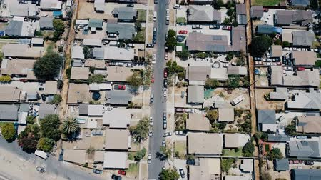neighbor : Beautiful aerial drone flyover shot of American suburb residential block district, peaceful neighborhood on a sunny day.