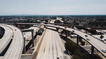bíró : Drone flying over famous Judge Pregerson freeway junction in Los Angeles, California with a metro station in the middle.