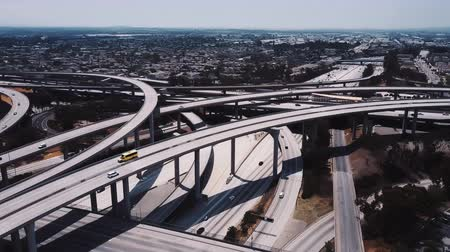 bíró : Drone flying around Judge Pregerson highway junction in Los Angeles, cars going over complex flyovers and intersections. Stock mozgókép