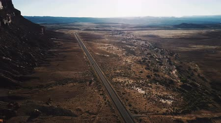 freedom tower : Cinematic aerial view of epic wide open desert wilderness of Arizona endless desert valley with car moving along highway