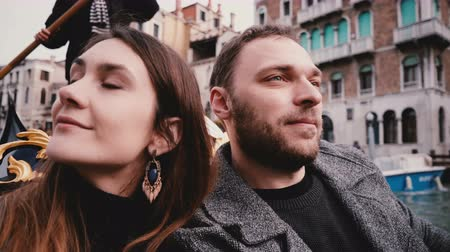 Close-up shot of happy smiling young European newlyweds in gondola enjoying Venice canal tour excursion on honeymoon. Stock Footage