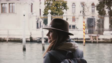 Back view of happy relaxed Caucasian tourist woman enjoying amazing gondola excursion tour during autumn Venice vacation Stock Footage