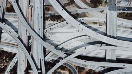 bíró : Drone flying right revealing amazing highway junction interchange with complex roads, levels and flyovers structure.