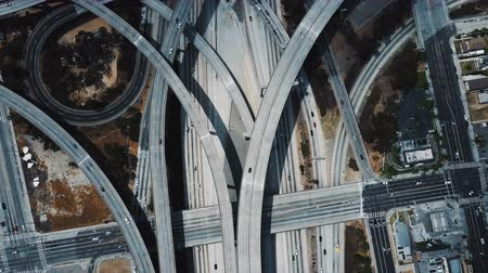 los angeles skyline : Beautiful drone flyover above large highway junction interchange with complex structure of multiple roads and flyovers. Stock Footage
