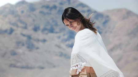 positive vibes : Beautiful young happy free local woman looking back at camera smiling and flirting at sunny salt desert lake in Utah. Stock Footage