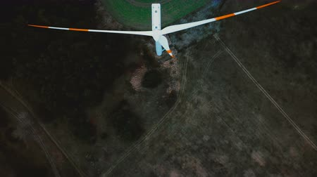 humanidade : Top view drone moving above windmill turbine with red blade marks, alternative renewable energy sources industry.