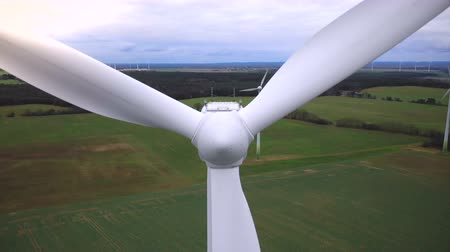 humanidade : Super close-up aerial shot of working white windmill turbine blades, alternative eco-friendly energy sources industry.