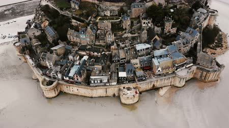 Нормандия : Aerial top view, drone flying above majestic Mont Saint Michel island town, famous ancient historic landmark in France. Стоковые видеозаписи