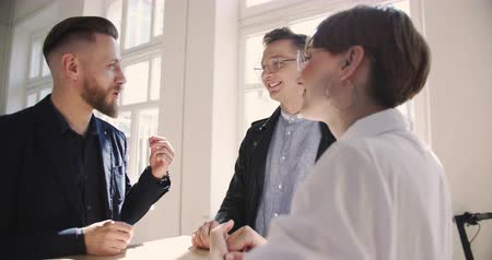 informal : Handsome successful middle aged businessman talking to young millennial partners at comfortable light modern loft office Stock Footage