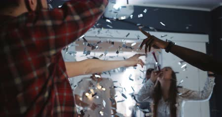 friendship dance : Happy young multiethnic students dance together at amazing fun party with confetti celebrating holidays slow motion.