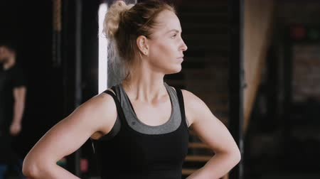 overcome : Close-up young beautiful fit blonde woman tired and exhausted, heavy breathing after jump rope gym workout slow motion. Stock Footage