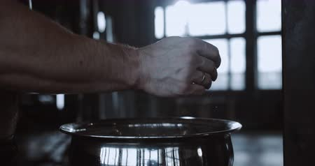aspire : Close-up hands of male weight lifter clapping with talc powder before exercising in large hardcore gym hall slow motion. Stock Footage