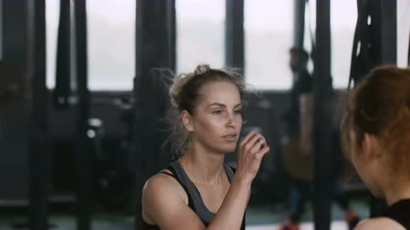 role model : Close-up young attractive blonde woman exercising with personal female fitness coach in gym doing aerobics slow motion. Stock Footage