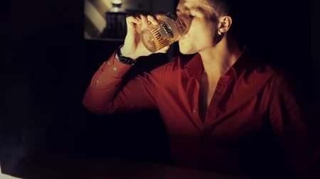 브랜디 : Man in a red shirt is drinking whiskey at the bar