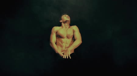 striptease : Sexy man dance in smoke background
