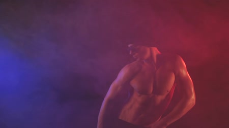 discotheque : Young man with sunglasses dancing on a smoky background Stock Footage