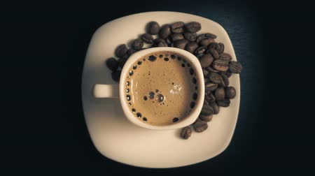 drinking coffee : Coffee cup and coffee beans Stock Footage