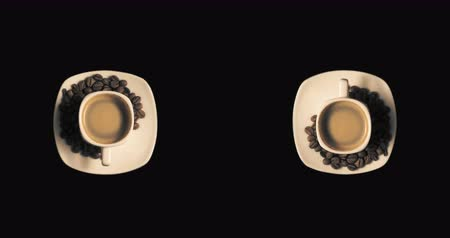 dark roast : Two cups with rotating coffee Stock Footage