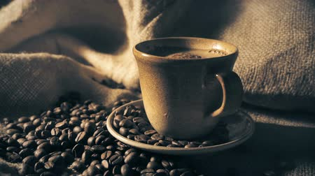 dark roast : Coffee cup and coffee beans Stock Footage