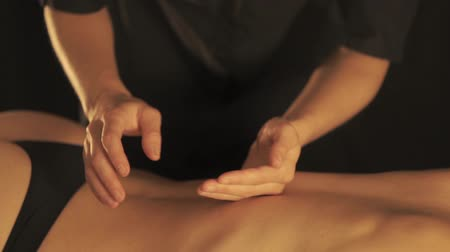 getting : Concept of massage. Beautiful young woman gets a relaxing massage