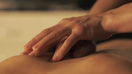 kap : Concept of massage. Beautiful young woman gets a relaxing massage